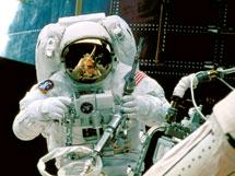 NASA astronaut on spacewalk on space shuttle